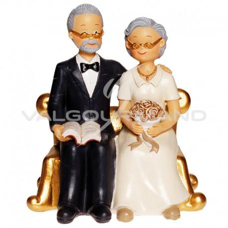 Couple de Seniors sur fauteuil doré H. 15cm - pièce